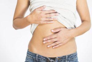 Вздутие живота и боли груди